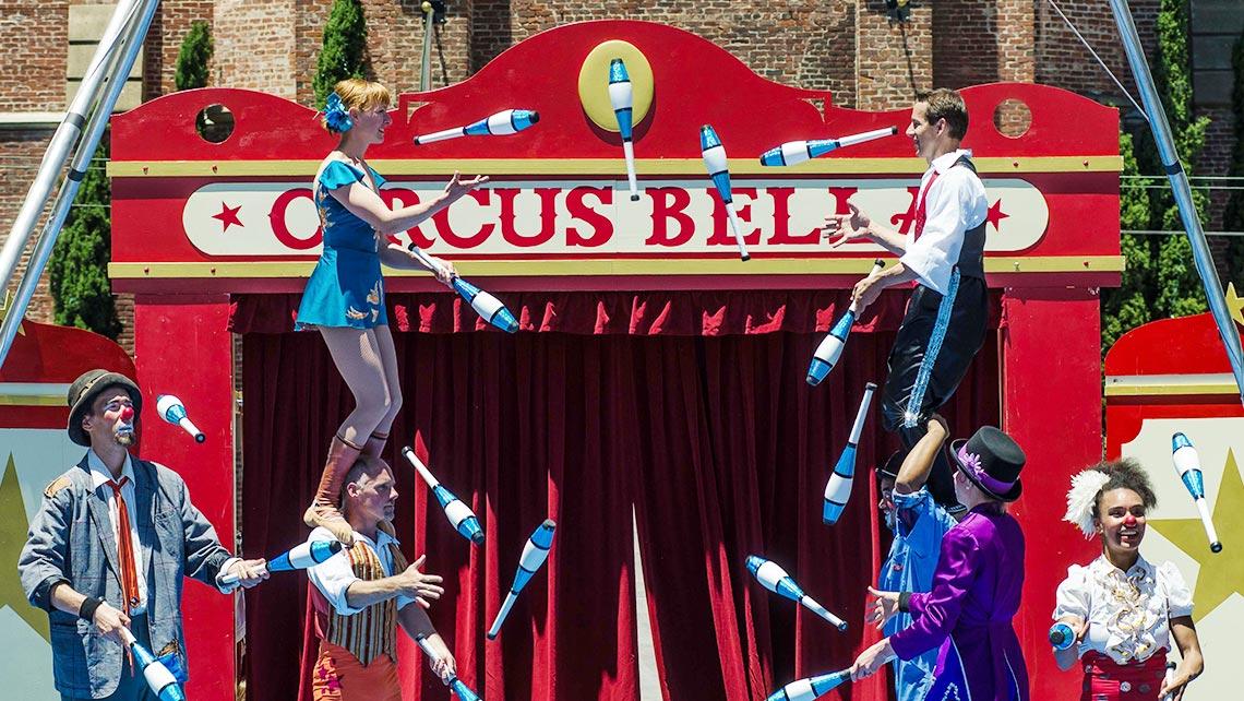 Photo of Circus Bella members juggling in formation