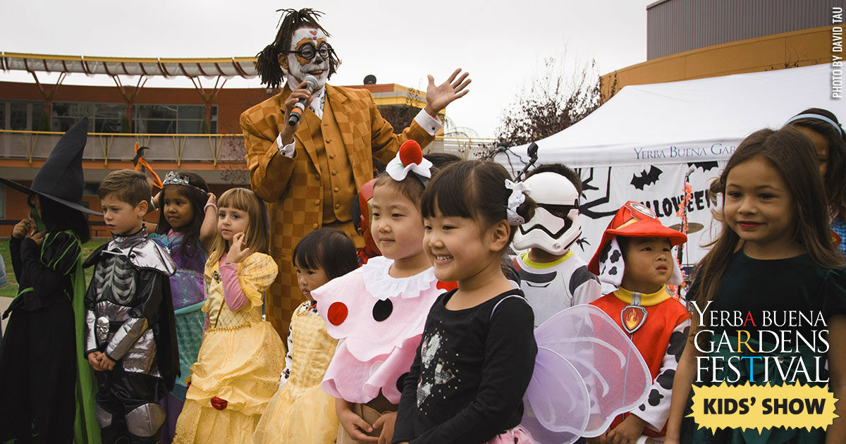 Photo of children in costume with clown Unique Derique at the Halloween Hoopla